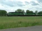 BNSF 9243 and BNSF 9289 in front of a fleet of SD60M's leading a coal drag east
