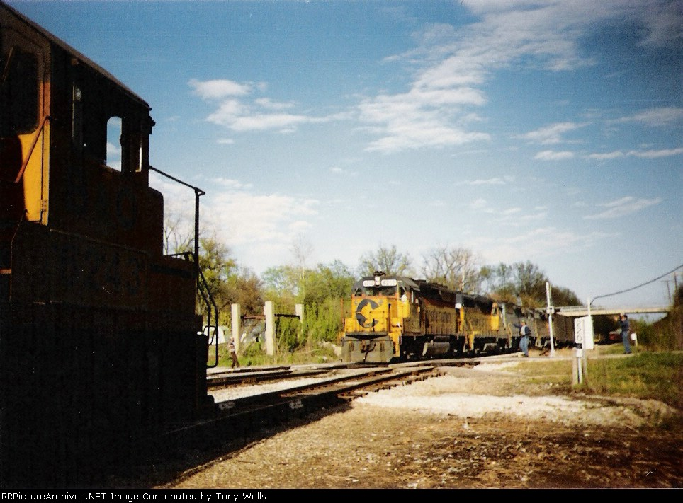 """The """"Wabash Flash"""" local waits on the wye for a passing freight"""