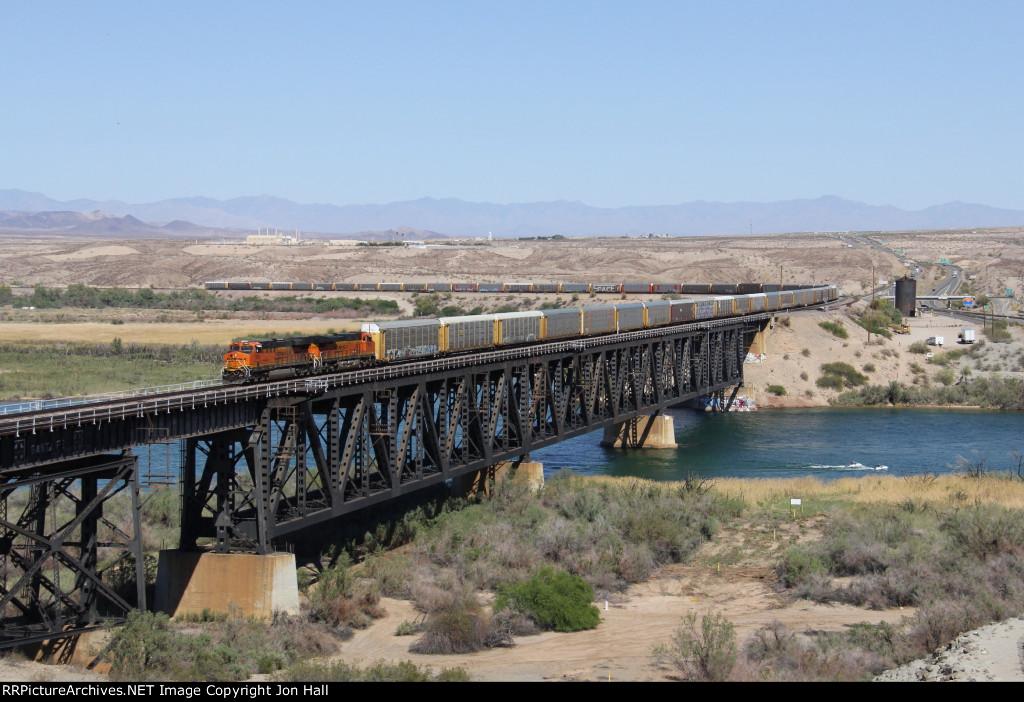 Westbound autoracks cross the Colorado River as V-BIRSBD1