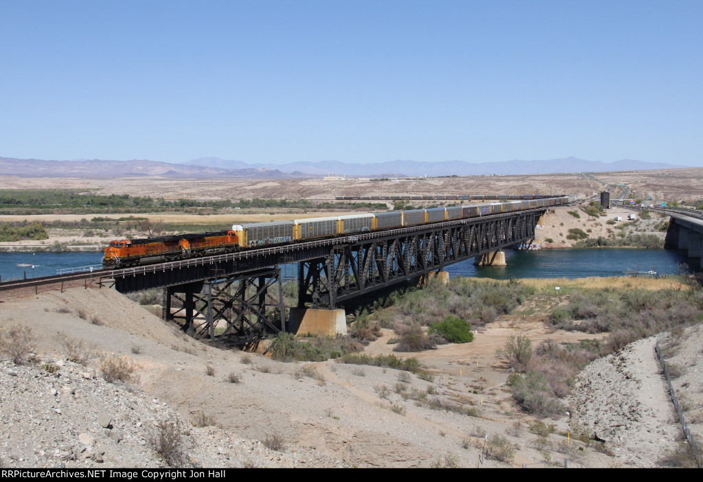 While crossing the Colorado River, V-BIRSBD1 rolls through a narrow oasis of vegetation in the desert