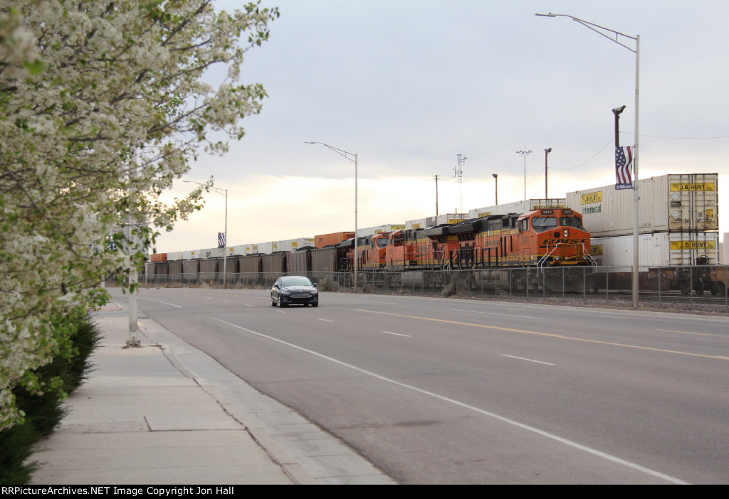Spring blossoms decorate the roadside as the DPU's of westbound coal loads head away