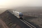 Railrunner 514 comes north as high winds continue to kick up a dust storm