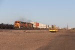 Passing parked MOW equipment, BNSF 4259 leads Q-STOCHI6 east under the morning sun