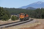 BNSF 6055 leads H-KCKBAR2 west in to the super elevated curve