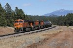 Humphreys Peak rises in the distance as 6055 heads west