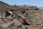 Part way up the canyon wall, BNSF 3929 leads H-BARTUL9 east