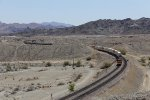 Below the Chemehuevi Mountains, Z-LPKLAC7 comes west through the sweeping curve near Park Moabi