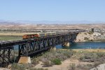 Westbound autoracks cross the Colorado River as V-BIRSBD1