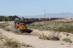With a long train stretched out behind it, BNSF 3740 rolls through the Kingman area