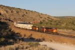 The evening shadows are growing as BNSF 4670 leads Z-ALTNBY7 west