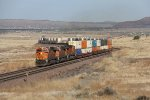 BNSF 6312 leads the way as Q-STOCHI6 winds through the curves