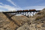 High above the canyon, BNSF 7967 leads Q-RICALT6 east