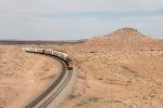 Q-CHISBD7 rolls west through the red rocks of the Painted Desert