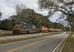 CSX 866, BNSF 5506 and 9890, and GECX 9406 slowly roll a line of tank cars across Jonesboro Rd