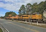 CSX 866, BNSF 5506 and 9890, and GECX 9406 pause for green
