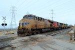 UP #7390, CN #5766, UP #5217 (ES-44AC, SD-75I, SD-70M) lead a southbound UP freight across W. 4000 N. in Pleasant View, UT. March 9, 2019