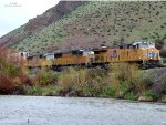 UP 7961, 4386, 3939 (ES-44AC, SD-70M, SD-70M) lead an eastbound stack train at the Weber River Access Center in Henefer, UT. May 8, 2019