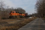 BNSF 8093 & 7657 charge west with oil empties