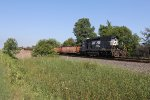 NS 1643 slowly rolls 95R west as MOW crews unload new ties