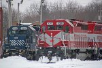 Closeup of HLCX 6334 and WAMX 4219 on the roundhouse leads
