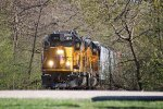UP's Janesville local rumbles through the spring greenery of Riverside Park