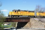 UP 1430 trundles above County Highway E as it leaves the city