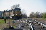 The conductor will line the east loop switch so UP 1430 can head back to Janesville