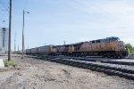 Two GE's lead an autorack train into Ogden