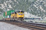A stack train rolls downgrade through Echo Canyon