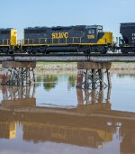 WAMX 4038 is reflected in the muddy waters of the Oklahoma River