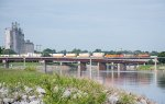 A BNSF stack train cruises across the Oklahoma River