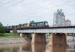A SLWC train starts across the Oklahoma River Bridge