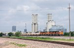A BNSF intermodal heads past some of the many elevators in Amarillo