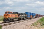 A westbound intermodal waits in the hole at