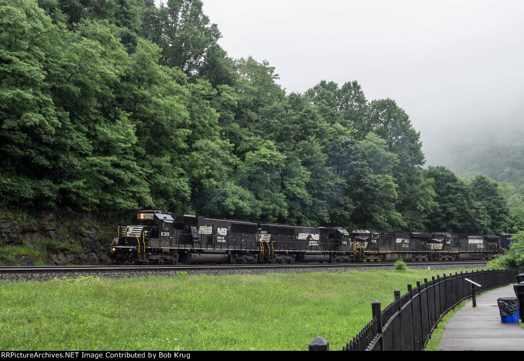 NS 6315 leads a westbound trash train around the Horseshoe Curve on a rainy June day.
