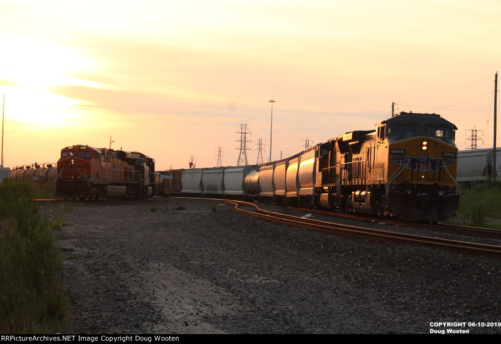 Union Pacific and Burlington Northern Santa Fe Waiting At Tower 87 In The Morning Light