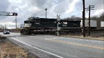 NS 7229 zips across the crossing and takes 2018 with it.