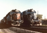 SP SD45R 7420 westbound passes a set of MoPac coal train helper units in San Antonio