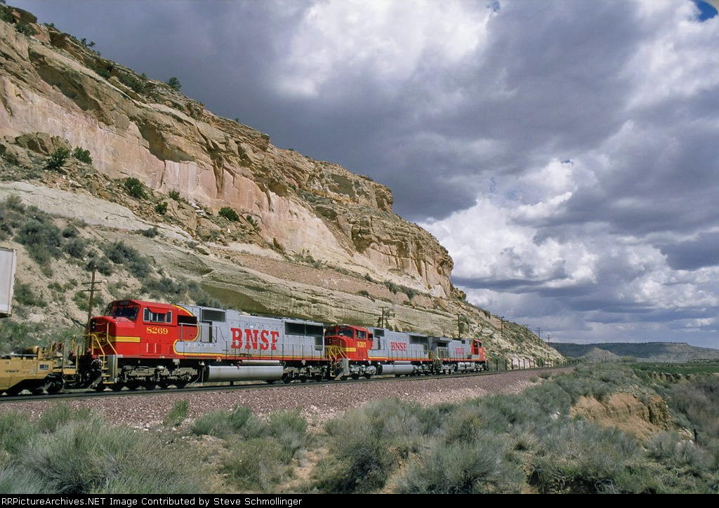 A BNSF eastbound stack train roars past the beautiful cliffs