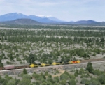 Santa Fe eastbound at West Perrin with the San Fancisco Peaks in the distance at