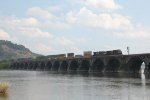 NS 9837 leads a westbound container train over Rockville bridge
