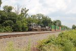 NS 6783 leads a westbound container train through cove PA