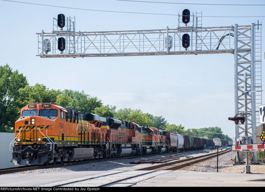 H-Minot-Northtown passes under the signal bridge at the west end of the Anoka Station
