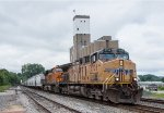 UP 5738 leads a grain train east on the River Sub