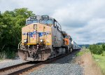 UP 5738 heads east through the small town of Frontenac