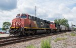 Two CN units lead a grain train east on the St Croix Sub