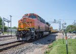 BNSF 6512 brings up the rear of a westbound MOW train