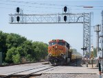 BNSF 6512 passes under the signals at the west end of the Anoka Station