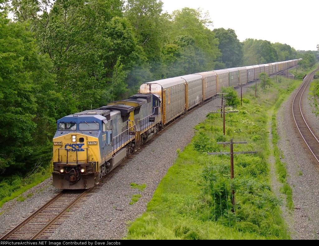 CSX 7707 heads a rack train