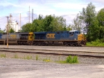 CSX 5306 leads a stacker at the west end of the yard